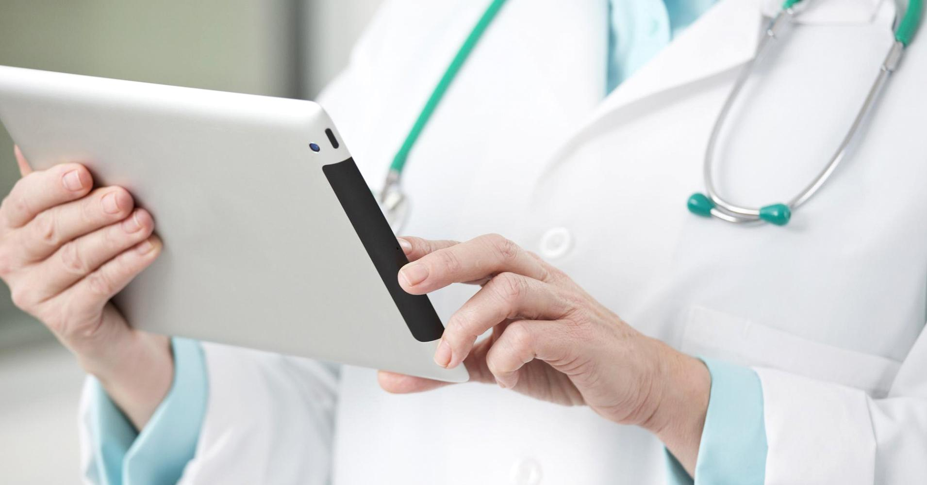 Image of a physician holding an iPad